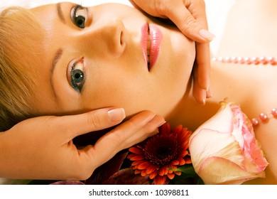 Beautiful woman enjoying a head massage