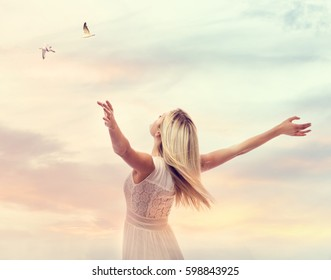 Beautiful woman enjoying her freedom with arms open