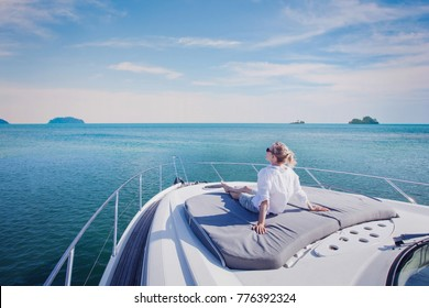 beautiful woman enjoying luxurious yacht cruise, sea travel by luxury boat - Shutterstock ID 776392324
