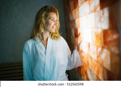 Beautiful woman enjoying salt spa treatment