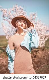 Beautiful woman enjoying spring and warm weather in nature. Film grain photo