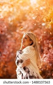 Beautiful woman enjoying in a sunny autumn day