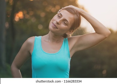 Beautiful woman enjoys exercising in the nature.Image is intentionally toned.