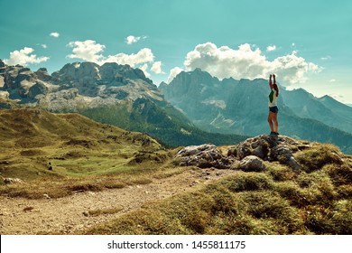 Beautiful woman enjoys a beautiful view of Mountains around Madonna di Campiglio Madonna di Campiglio in the summertime, Italy,Northern & Central Brenta mountain groups ,Western Dolomites