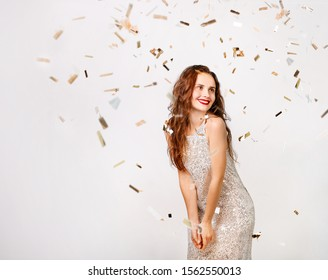Beautiful woman in a evening dress at a party on a white background