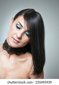 Beautiful woman and evening make-up.