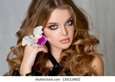 Beautiful woman with evening make-up and hairstyle.  Smokey eyes.