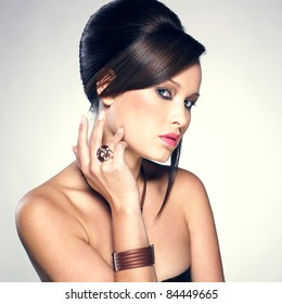 Beautiful woman with evening make-up and hairstyle. Jewelry and Beauty. Fashion photo