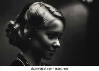 Beautiful woman with evening make-up. Jewelry and Beauty. Black and White photo