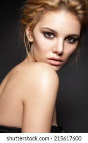 Beautiful woman with evening make-up and perfect skin . Smoky eyes. Fashion photo