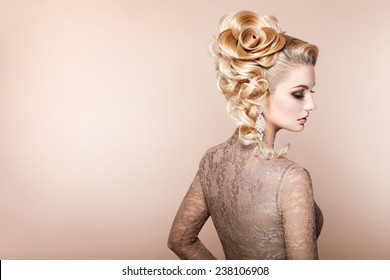 Beautiful woman with evening make-up and salon hairdo . Smoky eyes. Complicated hairstyle for party