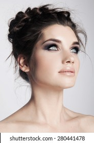Beautiful woman with evening make-up and salon hairdo . Smoky eyes.