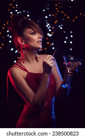 beautiful woman in evening red dress with cocktail with cigarette