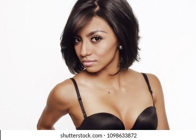 Beautiful woman with exotic dark looks.  Studio photo shoot.