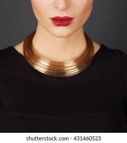 The beautiful woman in expensive necklace isolated