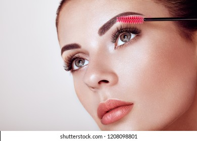Beautiful Woman with Extreme Long False Eyelashes. Eyelash Extensions. Makeup, Cosmetics. Beauty, Skincare