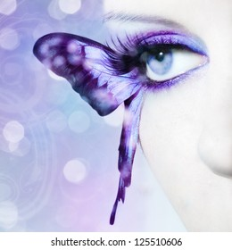 beautiful woman eye close up with butterfly