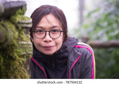 Beautiful woman with eyeglasses.  Closeup on face.