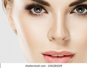Beautiful woman eyes lashes lips healthy skin closeup macro beauty