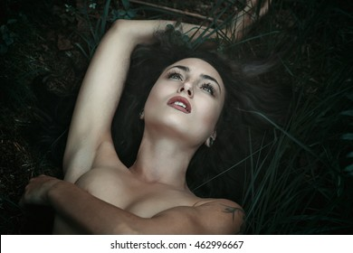 Beautiful woman with eyes to the sky. Forest portrait