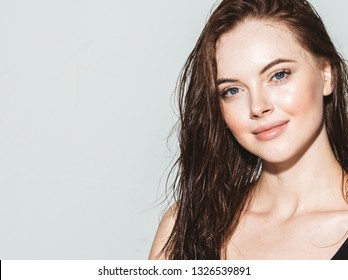 Beautiful woman face brunetee closeup with warm hair