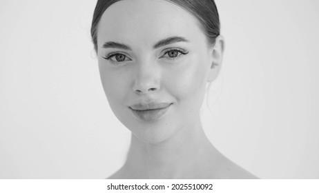 Beautiful woman face close up beauty young female monochome portrait