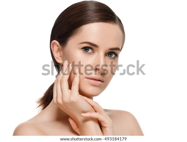 Beautiful woman face close up hand fingers touching face skin portrait studio on white