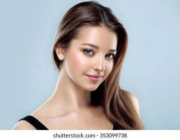Beautiful woman face close up portrait young studio on gray