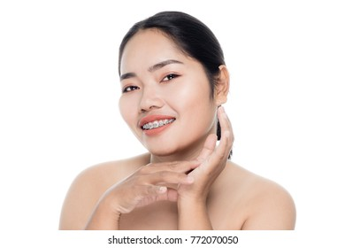 Beautiful woman face close up portrait studio on white background