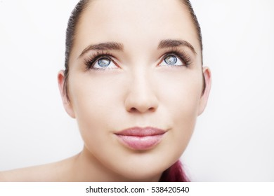 Beautiful woman face close up studio on white background.