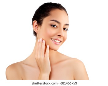 Beautiful woman face close up studio on white. Brunette model female girl with healthy skin. Hand touching skin.