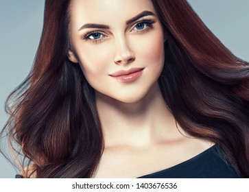 Beautiful woman face closeup with beauty makeup and brunette hair closeup