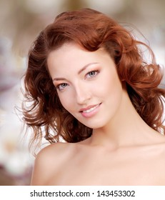 Beautiful woman face with curly hairs over art background