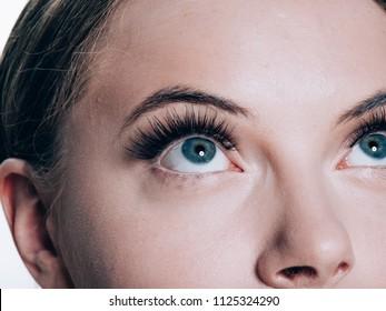 Beautiful woman face with eyelashes beauty healthy skin natural makeup