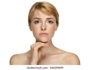 Beautiful woman face freckles blonde closeup portrait