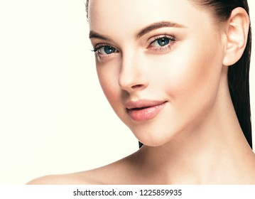 Beautiful woman face with healthy skin and beauty eyes lips brunette