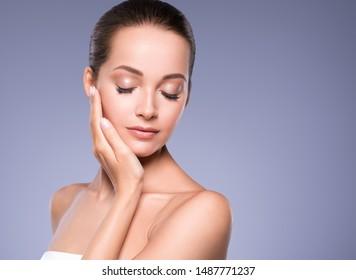 Beautiful woman face healthy skin and hair natural makeup beauty eyes lashes