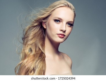 Beautiful woman face long blond hair lashes natural make up cosmetic female spa concept