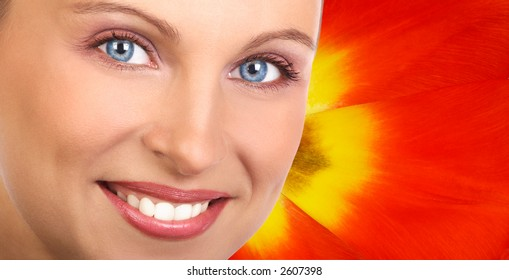 beautiful woman face over tulip background