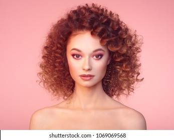 Beautiful woman face. Perfect makeup. Beauty fashion.  Cosmetic. Eyeshadow. Elegant afro curly hairstyle.