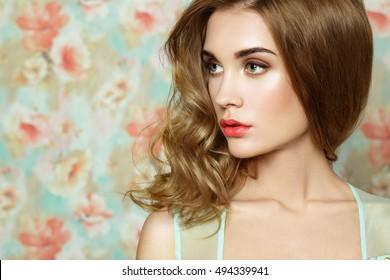 Beautiful woman face. Perfect makeup. Beauty fashion. Eyelashes. Cosmetic Eyeshadow. Elegant hairstyle.