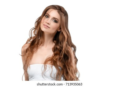Beautiful woman face portrait close up isolated on white with long brunette fly hair.