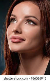 Beautiful woman face portrait close up on dark