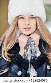 Beautiful woman face portrait in winter