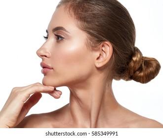 Beautiful woman face profile close up studio on white
