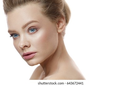 Beautiful Woman Face With Pure Healthy Smooth Soft Skin And Natural Professional Facial Makeup. Closeup Portrait Of Attractive Girl On White Background. Skin Care, Beauty Cosmetics. High Resolution