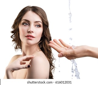 Beautiful woman face and splashes of water in hand. Cleansing and moisturizing concept.
