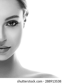 Beautiful woman face studio black and white half-face