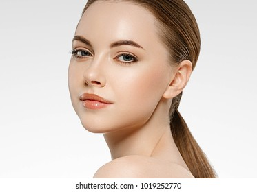 Beautiful woman face studio on white with sexy lips.