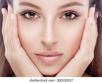 Beautiful woman face studio on white